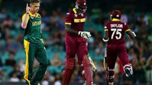 Jason Holder (second from left) walks off after being dismissed by fast bowler Dale Steyn (left) on Friday.