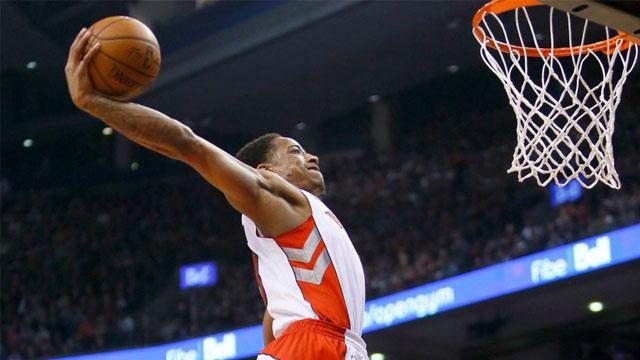 Raptors guard DeMar DeRozan goes for a dunk against the Rockets.