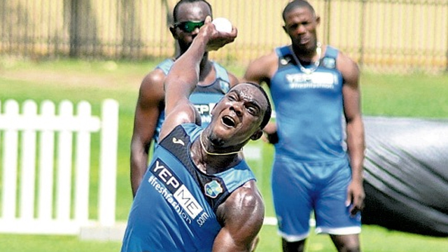 The West Indies' pace bowler Jerome Taylor about to deliver a ball during his team's training session at Murdoch University Oval, Perth, Australia, on Tuesday. (PHOTO: WICB MEDIA/PHILIP SPOONER)