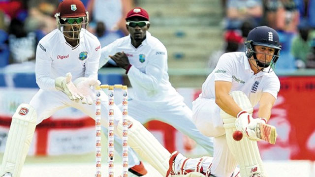 England's Gary Ballance sweeps a Sulieman Benn delivery on day four of the first Test at Vivian Richards Cricket Stadium, North Sound, Antigua on Thursday, yesterday. (PHOTO: WICB MEDIA/RANDY BROOKS)