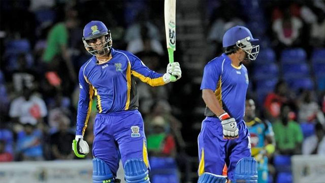 Man-of-the-Match: Shoaib Malik', left, celebrates reaching his half century which set up a 15-run win for the Barbados Tridents over the St Lucia Zouks in the Caribbean Premier League at Warner Park, Basseterre, St Kitts, on Wednesday. —Photo: CPL T20 Ltd