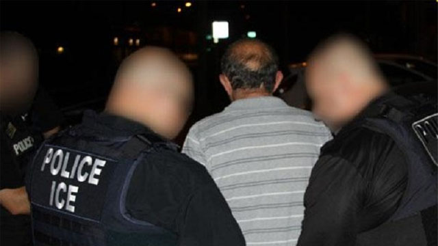 ICE OFFICERS MAKING ONE OF THE ARRESTS.