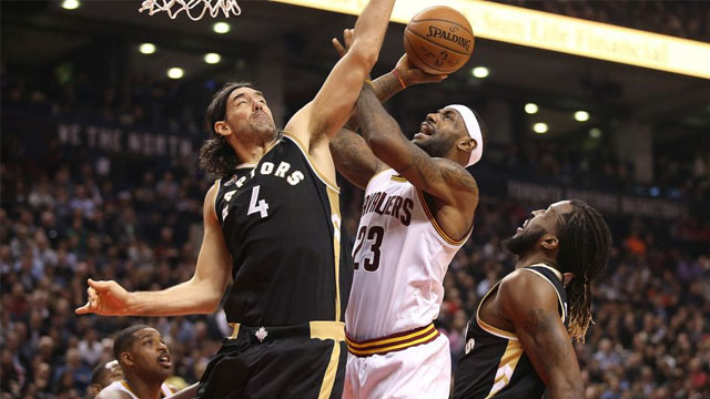 LeBron James, who scored 24, is fouled by the Raptors' Luis Scola.