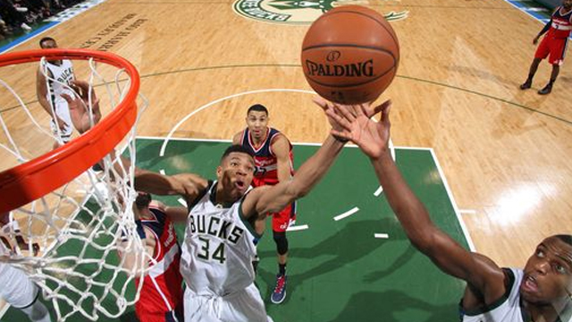 Milwaukee, WI - FEBRUARY 11: Giannis Antetokounmpo #34 of the Milwaukee Bucks and Khris Middleton #22 of the Milwaukee Bucks go after a rebound against the Washington Wizards on February 11, 2016 at the BMO Harris Bradley Center in Milwaukee, Wisconsin. (Photo by Gary Dineen/NBAE via Getty Images)