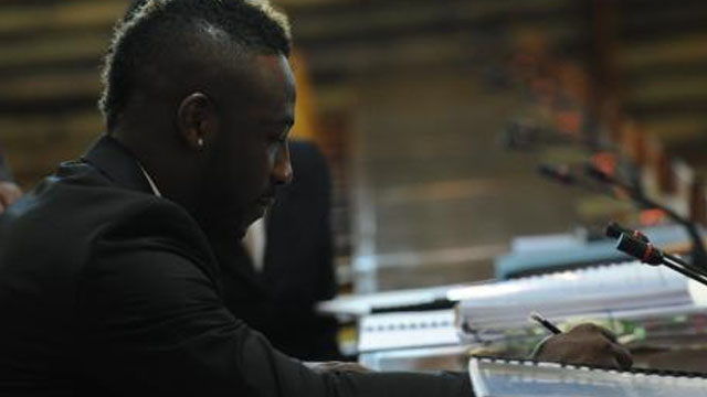 Jamaica and West Indies cricketer André Russell makes a note during a recent Jamaica Anti-Doping Disciplinary Panel hearing at the Jamaica Conference Centre in Kingston.