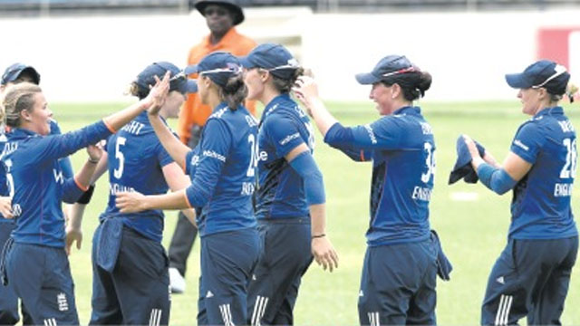 England Women celebrate victory against West Indies Women to clinch their five-match ODI series 3-2 at Sabina Park yesterday.
