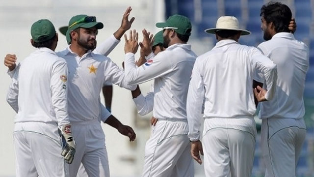Pakistani cricketers celebrate after the dismissal of West Indies' batsman Darren Bravo (unseen) on the fourth day of the second Test between Pakistan and the West Indies at the Sheikh Zayed Cricket Stadium in Abu Dhabi on October 24, 2016