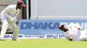 THAT'S NOT THE WAY: West Indies fielder Darren Bravo fails to take a catch in the first Test against Bangladesh at Arnos Vale Sports Complex, Kingstown, St Vincent on Tuesday. At left, captain Denesh Ramdin is far from amused. Despite sloppy fielding, West Indies won the match by 10 wickets.