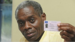 Lloyd Bogle shows his UK driver's licence to the Observer on Monday. ([PHOTO: BRYAN CUMMINGS)