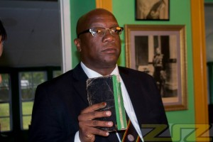 Hon. Timothy Harris repeating the oaths