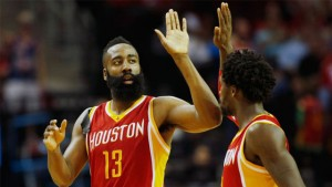 The Rockets' James Harden (left) celebrates with Patrick Beverley after hitting a 3-point shot against the Nuggets.