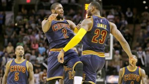 Cleveland Cavaliers Kyrie Irving (2) and LeBron James (23) celebrate during overtime of Thursday's 128-125 win at San Antonio. Irving scored 57 points, James 31.