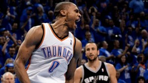 Russell Westbrook lets out a scream after scoring ahead of the Spurs' Manu Ginobili (r.) as the Thunder win Game 3.
