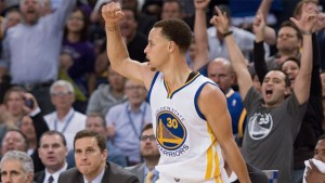 Warriors guard Stephen Curry celebrates after a play against the Lakers during the fourth quarter.