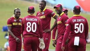 Windies skipper Jason Holder (centre) celebrate one of his four wickets with team-mates