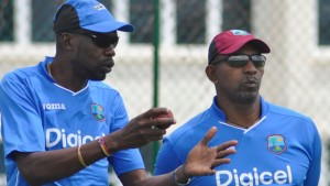 Sir Curtly Ambrose (left) chats with new coach Phil Simmons during a training session at the Sir Vivian Richards Cricket Ground earlier this week. (WICB Media)