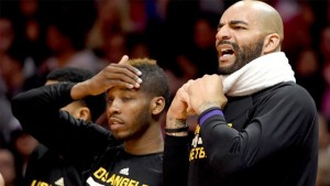 The looks the faces of the Lakers' Dwight Buycks (left) and Carlos Boozer say it all about Tuesday's game ... and this season.