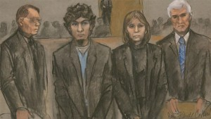 An artist's rendering of Dzhokhar Tsarnaev, second from left, and his defense team as the guilty verdicts on all charges were read in the Boston Marathon bombing trial on April 8, 2015.