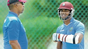New West Indies head coach Phil Simmons (left) and senior batsman Marlon Samuels chat at practice yesterday before the first Test against England at Vivian Richards Cricket Stadium, North Sound, Antigua. (PHOTO: WICB MEDIA/RANDY BROOKS)