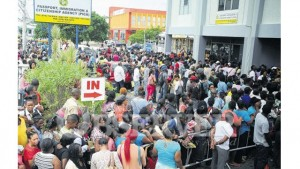 Hundreds of customers gather yesterday at the front of the passport office to process their documents before a May 26 rise in application fees that was later pushed back to June 1.