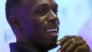 Jamaican sprinter Usain Bolt smiles during a press conference in Rio de Janeiro, Brazil, Friday, April 17, 2015.