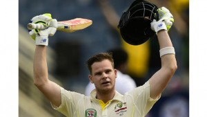 Australia's Steve Smith reacts after scoring 100 runs, on the first day of the second cricket Test between Australia and the West Indies. (Photo: AFP)