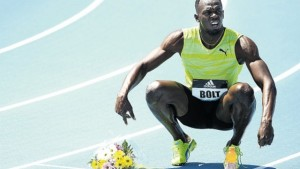 Bolt sits on the track pondering his next move after winning in New York last Saturday. Bolt ran 20.29 seconds in the 200m. (PHOTO: AFP)