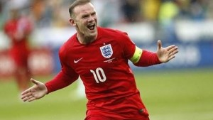 MILESTONE: England's Wayne Rooney celebrates his goal during the Euro 2016 Group E qualifying match against Slovenia, in Ljubljana, Slovenia, yesterday. --AP Photo
