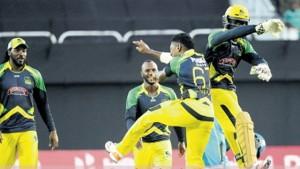Jamaica Tallawahs wicketkeeper Chadwick Walton (right) celebrates with Krishmar Santokie (#67) after stumping Andre Fletcher of St Lucia Zouks during their Hero CPL T20 game at Sabina Park last night. (