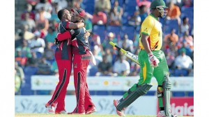 Trinidad and Tobago Red Steel Captain Dwayne Bravo (left) and brother Darren Bravo celebrate one of the wickets against Guyana Amazon Warriors at Warner Park on Saturday. (PHOTO: CPL T20 LTD.2015)
