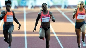 Gold medallist Veronica Campbell Brown (centre) of Jamaica competes with second-placed Tianna Bartoletta (left) of the USA, and Kaylin Whitney also of the USA during the women's 100 metres final of the Gyulai Istvan Memorial – Hungarian Athletics Grand Prix at the athletic centre of Szekesfehervar, Hungary, yesterday. (PHOTO: AFP)