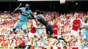 West Ham United's Senegalese midfielder Cheikhou Kouyate (left) scores the opening goal of the English Premier League football match against Arsenal at the Emirates Stadium in London yesterday.