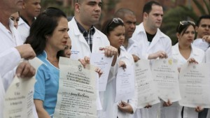 Cuban doctors show their diplomas during a protest to draw attention to their plight to get U.S. visas on Saturday.