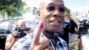 Trinidad and Tobago's Prime Minister-elect Dr Keith Rowley shows his inked finger after voting in yesterday's general election. Rowley led his People's National Movement to victory over the Kamla Persad-Bissessar led People's Partnership coalition.