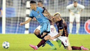 Barcelona's Brazilian forward Neymar (centre) is tackled by Roma's Belgian midfielder Radja Nainggolan (right) and midfielder Seydou Keita during their UEFA Champions League match at Rome Olympic stadium, yesterday. The match ended 1-1.