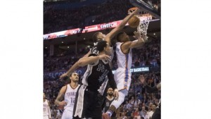 Danny Green #14 and Tim Duncan #21 of the San Antonio Spurs try to stop Russell
