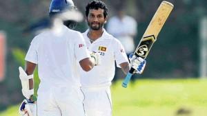 Sri Lanka batsman Dimuth Karunaratne celebrates his century on day one of the first Test match against the West Indies at the International Cricket Stadium, Galle, Sri Lanka, yesterday.