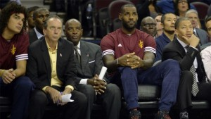 LeBron James says he won't be sitting on the bench when the season tips off Tuesday.
