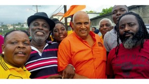 Businessman Peter Blake (centre) is congratulated by supporters, among them Councillor Oliver Clue (second left), after his victory in yesterday's selection exercise to determine the PNP's general election candidate for St Andrew East Rural. The selection was held at PNP headquarters on Old Hope Road, St Andrew