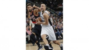 Manu Ginobili put the Spurs on his back in the fourth quarter, scoring 14 points to lead them past Portland.