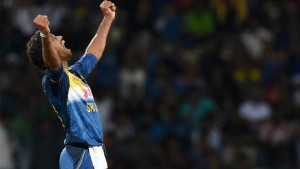 Sri Lanka's Sachithra Senanayake celebrates after taking the wicket of West Indies' Marlon Samuels during the first Twenty20 International cricket match at the Pallekele International Cricket Stadium in Pallekele on November 9, 2015