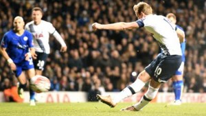 Tottenham Hotspur's English striker Harry Kane shoots to score a penalty against Leicester City in their FA Cup match at White Hart Lane in north London, yesterday. The game ended 2-2.