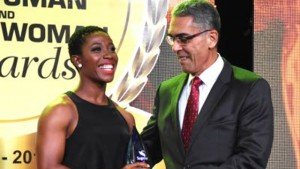 Sagicor Group President and CEO Richard Byles presents Shelly-Ann Fraser-Pryce with the Sagicor Iconic Award at the RJR National Sportsman and Sportswoman Awards ceremony at the Jamaica Pegasus Hotel on Friday.