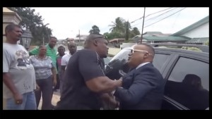 A screenshot from the video showing the altercation between Ian Alleyne (right) and Inspector Roger Alexander.
