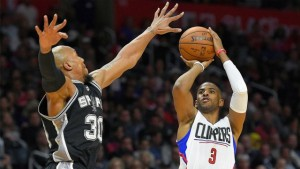 Clippers guard Chris Paul goes for 28 points and 12 assists against David West and the Spurs on Thursday in Los Angeles. The Clippers won 105-86.