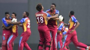Men of the moment: Antigua & Barbuda's bowling sensation Alzarri Joseph is the first to congratulate man-of-the-match Keacy Carty after the West Indies under-19s beat India yesterday to lift the ICC Youth Cricket World Cup yesterday. Joseph paved the way for the victory charge with an impressive spell of bowling, while Carty sealed the win with an unbeaten half-century.