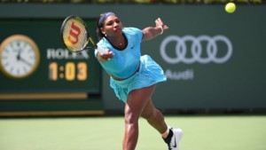 Serena Williams of USA returns the ball to Victoria Azarenka of Belarus in the women's final of the BNP Paribas Open at the Indian Wells Tennis Garden.