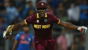 West Indies's Andre Russell celebrates after scoring the winning runs during the World T20 men's semi-final match between India and West Indies at The Wankhede Cricket Stadium in Mumbai on March 31, 2016. (Photo: AFP)