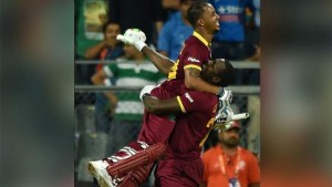 West Indies Lendl Simmons celebrates with a teammate after winning the World T20 cricket tournament semi-final match against India at The Wankhede Cricket Stadium in Mumbai on March 31, 2016.