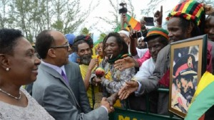 MINISTER OF CULTURE, GENDER, ENTERTAINMENT AND SPORT, OLIVIA GRANGE (LEFT), LOOKS ON AS HIS IMPERIAL HIGHNESS PRINCE ERMIAS SAHLE-SELASSIE, GREETS MEMBERS OF THE RASTAFARI COMMUNITY AT THE NORMAN MANLEY INTERNATIONAL AIRPORT.